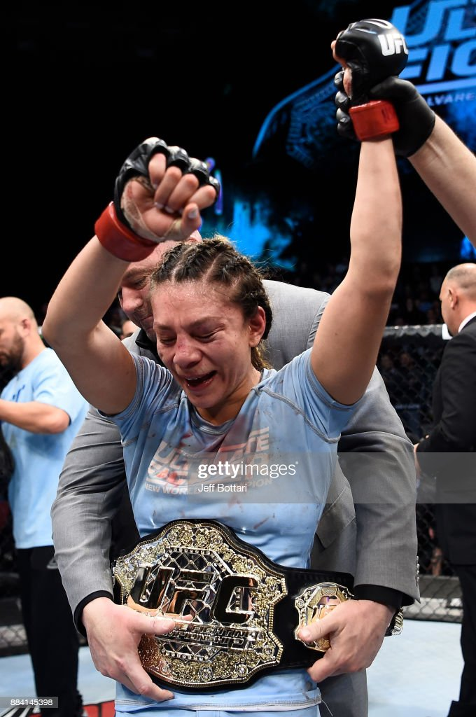 Nicco Montano celebrates her unanimous-decision victory over Roxanne Modafferi in their women's flyweight championship bout during the TUF Finale event inside Park Theater on December 01, 2017 in Las Vegas, Nevada.