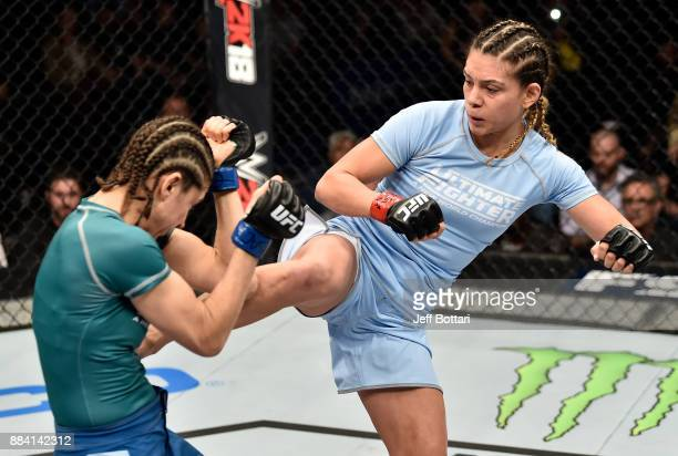Nicco Montano kicks Roxanne Modafferi in their women's flyweight championship bout during the TUF Finale event inside Park Theater on December 01...