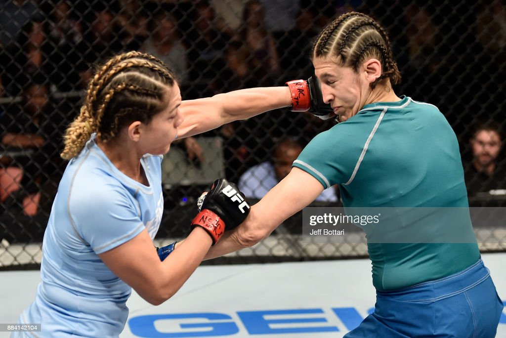 Nicco Montano punches Roxanne Modafferi in their women's flyweight championship bout during the TUF Finale event inside Park Theater on December 01, 2017 in Las Vegas, Nevada.