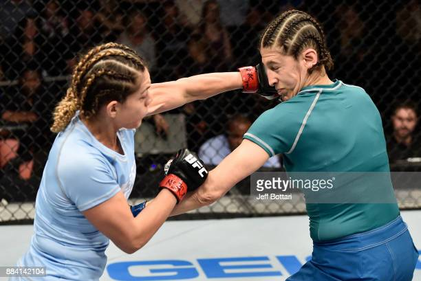 Nicco Montano punches Roxanne Modafferi in their women's flyweight championship bout during the TUF Finale event inside Park Theater on December 01...