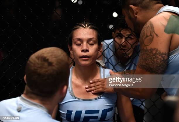 Nicco Montano receives advice from head coach Justin Gaethje in between rounds while facing Lauren Murphy during the filming of The Ultimate Fighter...