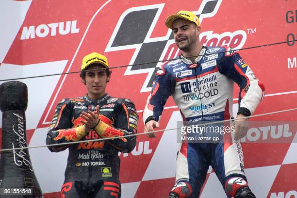 Niccolo Antonelli of Italy and Red Bull KTM Ajo and Romano Fenati of Italy and Marinelli Rivacold Snipers Team celebrate on the podium at the end of...