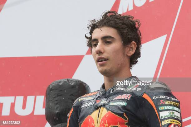 Niccolo Antonelli of Italy and Red Bull KTM Ajo celebrates the second place on the podium at the end of the Moto3 race during the MotoGP of Japan...