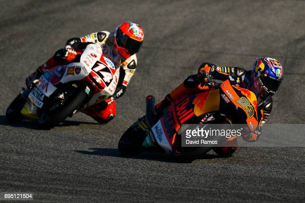 Niccolo Antonelli of Italy and Red Bull KTM Ajo rides ahead of Tony Arbolino of Italy and SIC58 Squadra Corse during the Moto3 warmup ahead of the...