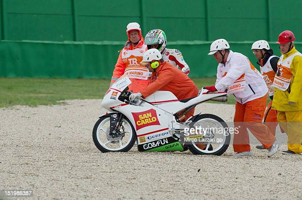 Niccolo Antonelli of Italy and San Carlo Gresini Moto3 walks with a marshall after crashed out during the free practice of the MotoGP of San Marino...