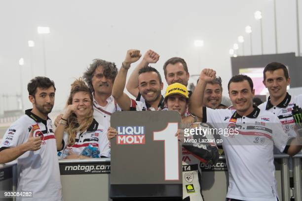Niccolo Antonelli of Italy and Sic 58 Squadra Corse Honda celebrates the pole position with team at the end of the qualifying practice during the...