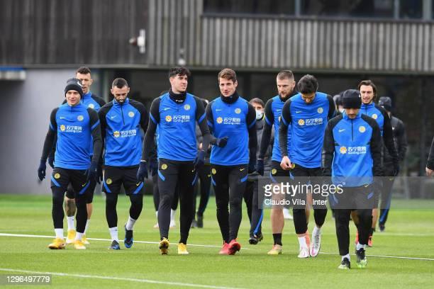 Niccolo Barella, Marcelo Brozovic, Alessandro Bastoni, Andrea Pinamonti, Milan Skriniar and Andrea Ranocchia attend an FC Internazionale training...