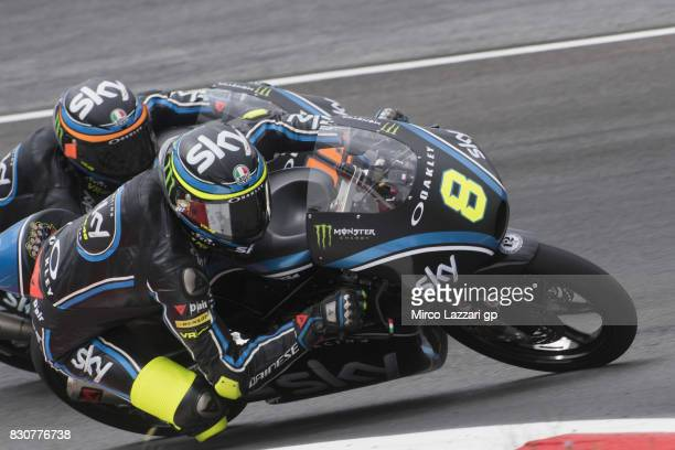 Niccolo Bulega of Italy and Sky Racing Team VR46 and Andrea Migno of Italy and Sky Racing Team VR46 round the bend during the MotoGp of Austria...