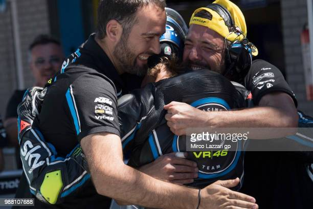 Niccolo Bulega of Italy and Sky Racing Team VR46 celebrates with team the third place at the end of the Moto3 Qualifying practice during the MotoGP...
