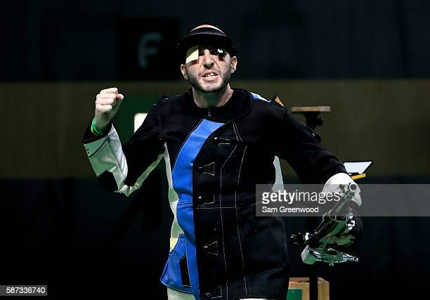Niccolo Campriani of Italy reacts to winning the 10m Air Rifle event on Day 3 of the Rio 2016 Olympic Games at the Olympic Shooting Centre on August...