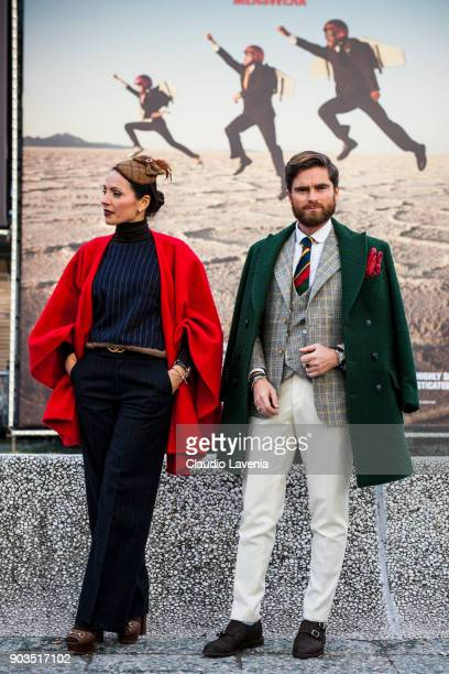 Niccolo Cesari wearing a green casentino coat Tacs 1962 and his wife Eva Berni wearing red casentino coat Tacs 1962 and a Atelier Ralitza hat are...
