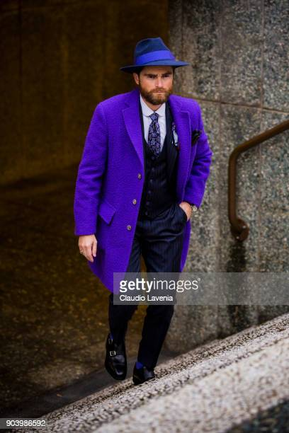 Niccolo Cesari wearing a purple casentino coat is seen during the 93 Pitti Immagine Uomo at Fortezza Da Basso on January 11 2018 in Florence Italy