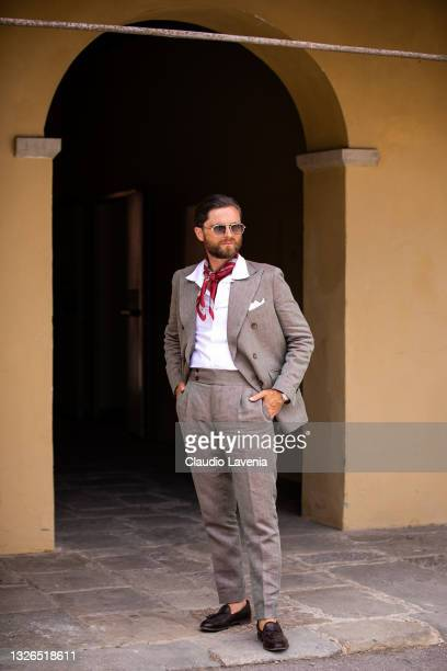 Niccolo Cesari, wearing grey suits, is seen at Fortezza Da Basso on July 01, 2021 in Florence, Italy.