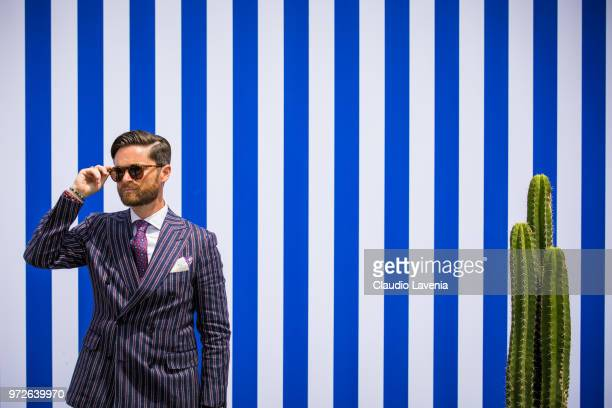 Niccolo Cesari wearing striped jacket is seen during the 94 Pitti Immagine Uomo at Fortezza Da Basso on June 11 2018 in Florence Italy