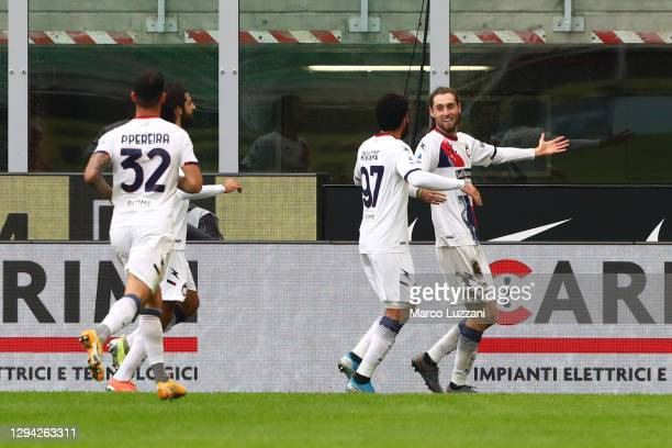 Niccolo Zanellato of F.C. Crotone celebrates with teammates Emmanuel Riviere and Pedro Pereira after scoring their team's first goal during the Serie...