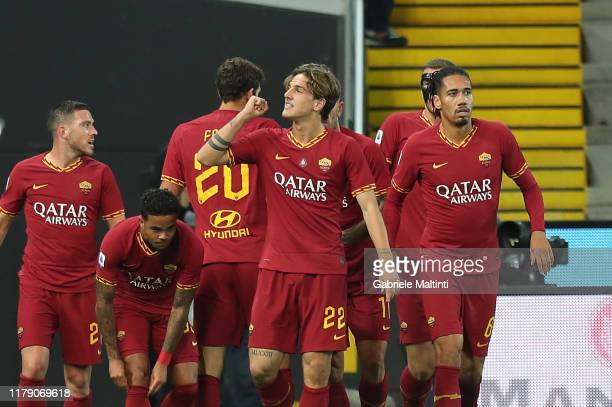 Niccolo' Zaniolo of AS Roma celebrates after scoring a goal during the Serie A match between Udinese Calcio and AS Roma at Stadio Friuli on October...