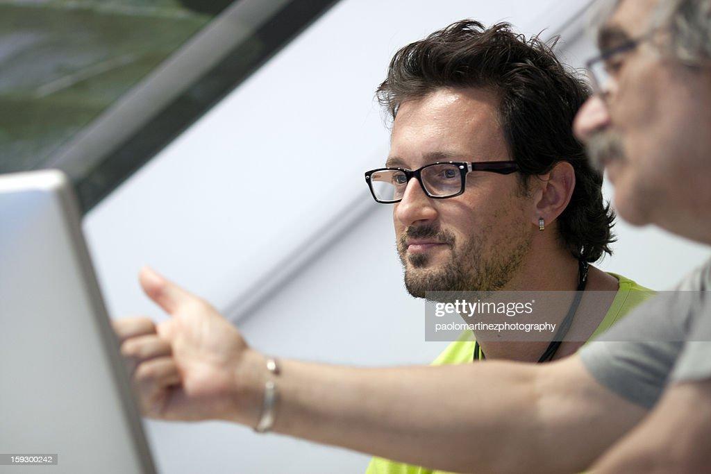 Nice boy with glasses during informatics class : Bildbanksbilder