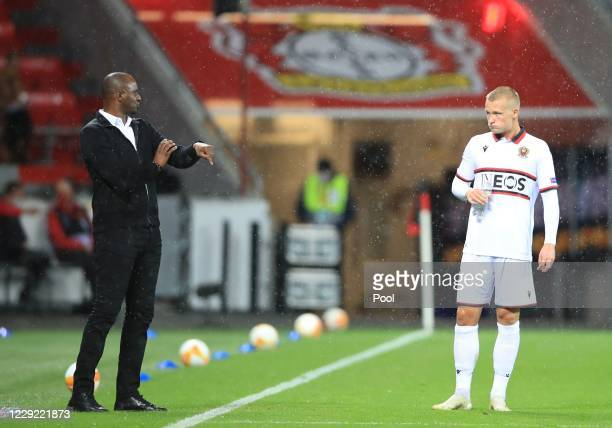 Nice coach Patrick Vieira talks to Kasper Dolberg during the UEFA Europa League Group C stage match between Bayer 04 Leverkusen and OGC Nice at...