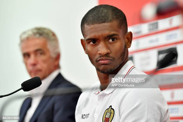 OGC Nice football club's new recruit Brazilian defender Santos Marlon listens during a press conference to present the club's new players on...