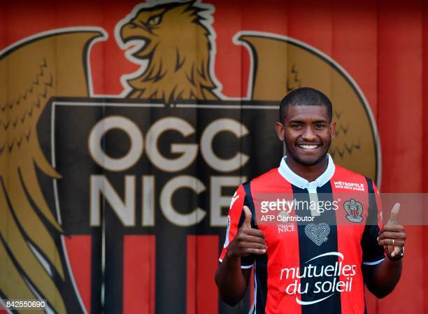 OGC Nice football club's new recruit Brazilian defender Santos Marlon poses with his new jersey during the official presentation of the club's new...