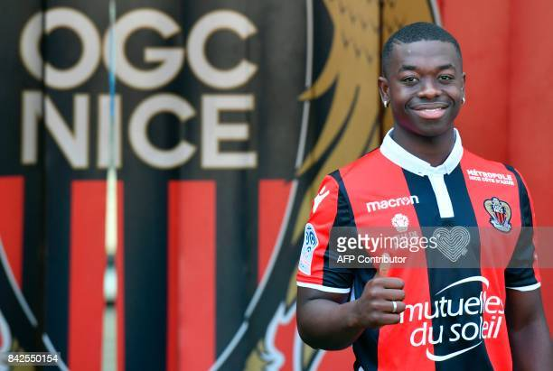 OGC Nice football club's new recruit French midfielder Nampalys Mendy poses with his new jersey during the official presentation of the club's new...