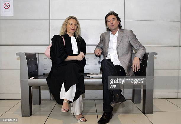 Defense's lawyers Melanie Junginder and Franck De Vita wait for the beginning of the third day of the trial of their client Mohammed M'Baerk accused...