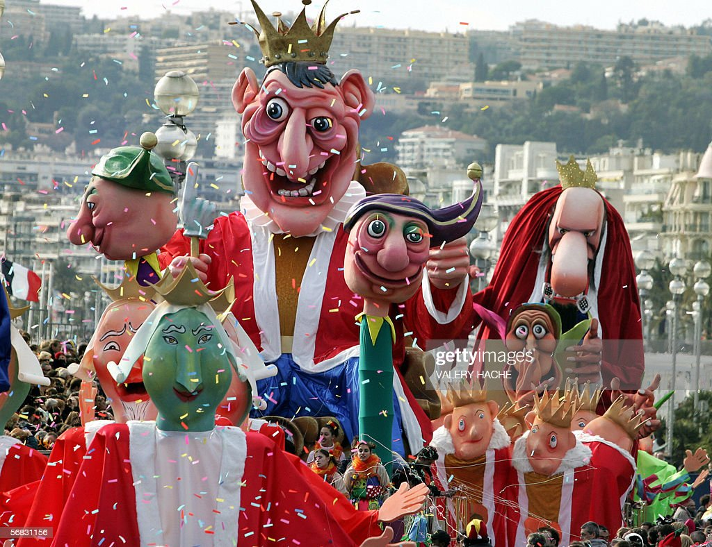 People take part in a parade of the 122nd Nice carnival, 12 February 2006 in Nice, south eastern France, on the second day of the event.