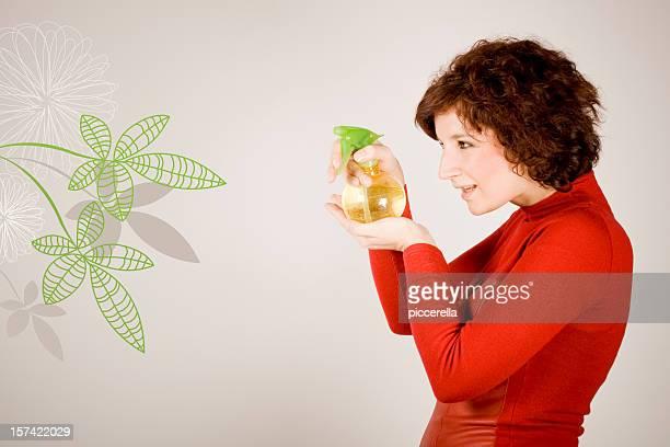 Nice girl sprinkling a vector plant
