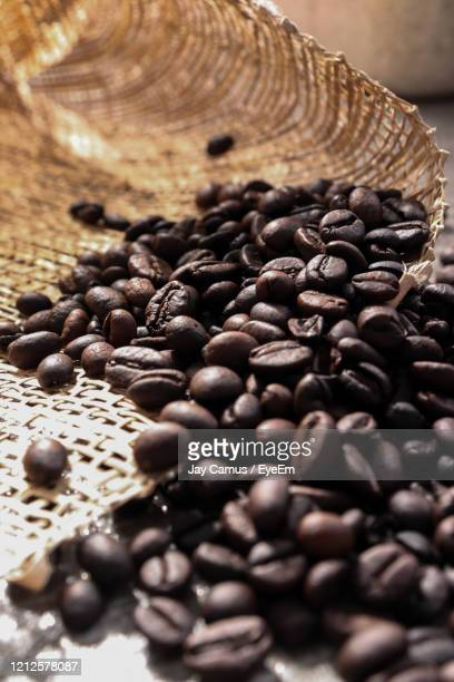 a nice grams of black coffee beans harvested to be brewed for a quality cup of coffee drink. - coffee drink stock pictures, royalty-free photos & images