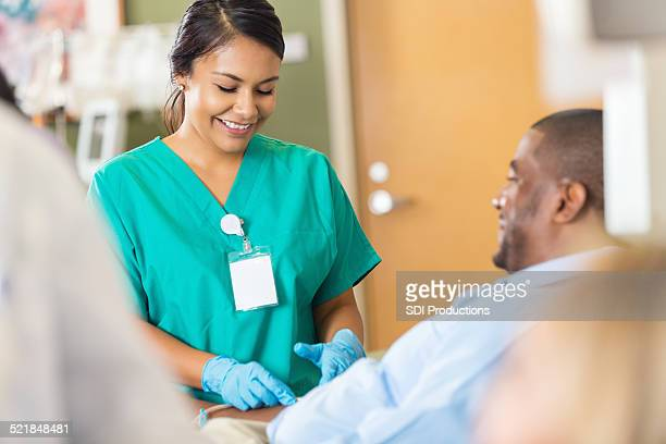 Nice hospital phlebotomist taking a sample from a patient