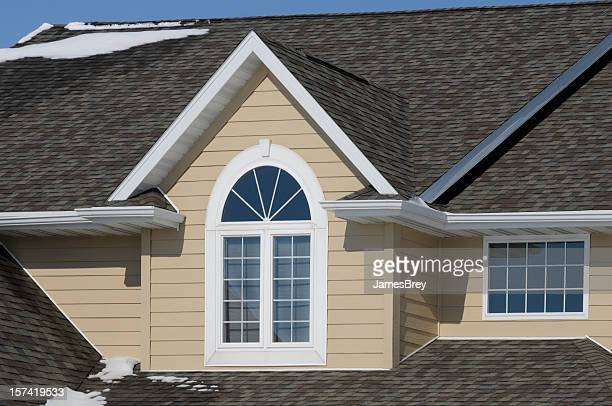Nice House with Gabled Asphalt Shingle Roof and Snow