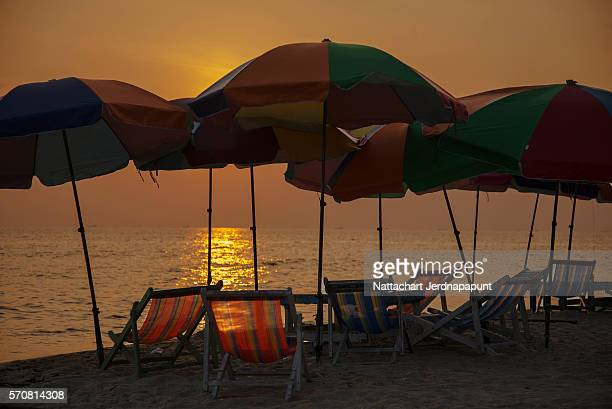 nice landscape of beach chair with sunset in dusk,pay beach,rayong,thailand - margarita beach stock photos and pictures