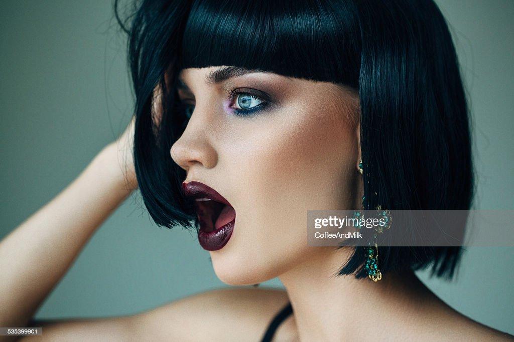 Nice looking woman with beautiful earings : Stock Photo