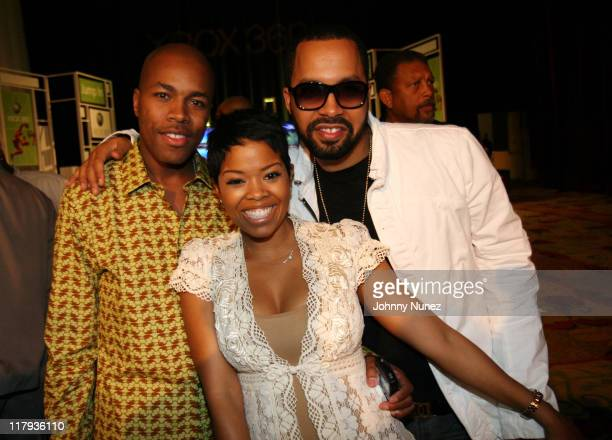 Nice Malinda Williams and Kenny Burns during Boost Mobile's Zo and Magic Johnson 8Ball Challenge Celebrity Pool Tournament at Wynn Las Vegas in Las...