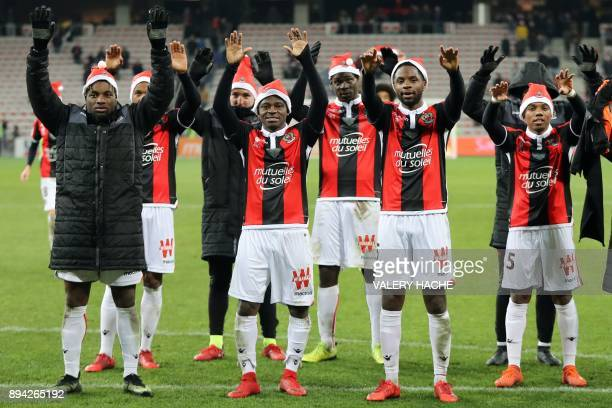 Nice players celebrate at the end of the French L1 football match Nice vs Bordeaux on December 17 2017 at the 'Allianz Riviera' stadium in Nice...