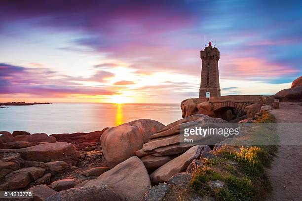 nice sunset at lighthouse ploumanac'h, pink granit coast, bretagne - cotes d'armor stock photos and pictures