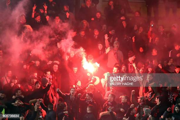 Nice supporters react after a goal during the French L1 football match Monaco vs Nice on January 16 2018 at the Louis II Stadium in Monaco / AFP...
