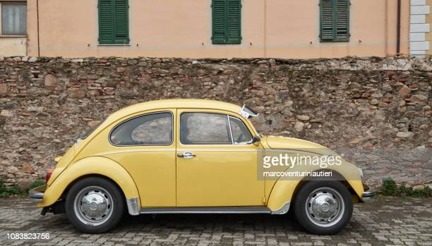 nice yellow volkswagen beetle parked in Italy