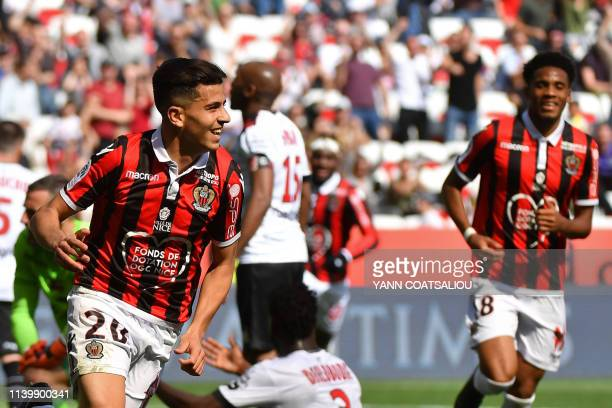 Nice's Algerian defender Youcef Atal celebrates after scoring his second goal during the French L1 football match between OGC Nice and En Avant...