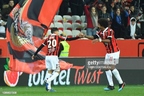 Nice's Algerian defender Youcef Atal celebrates with a teammate after scoring a goal during the French L1 football match between Nice and Nimes on...