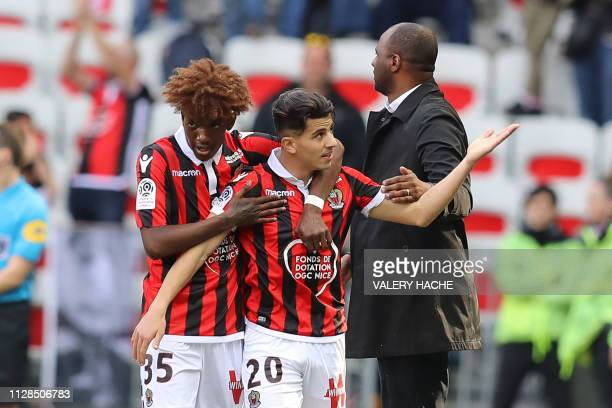 Nice's Algerian defender Youcef Atal celebrates with Nice's French coach Patrick Vieira and Nice's French defender Andy Pelmard after scoring a goal...