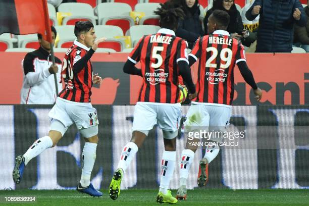 Nice's Algerian defender Youcef Atal celebrates with teammates after scoring a goal during the French L1 football match between Nice and Nimes on...