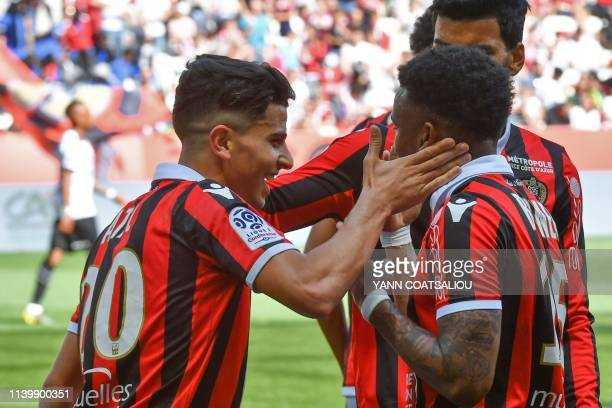Nice's Algerian defender Youcef Atal celebrates with teammates after scoring his second goal during the French L1 football match between OGC Nice and...