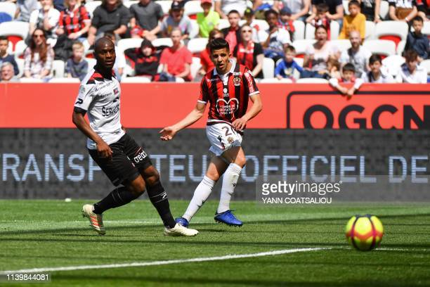 Nice's Algerian defender Youcef Atal kicks to score during the French L1 football match between OGC Nice and En Avant Guingamp at the Allianz Riviera...