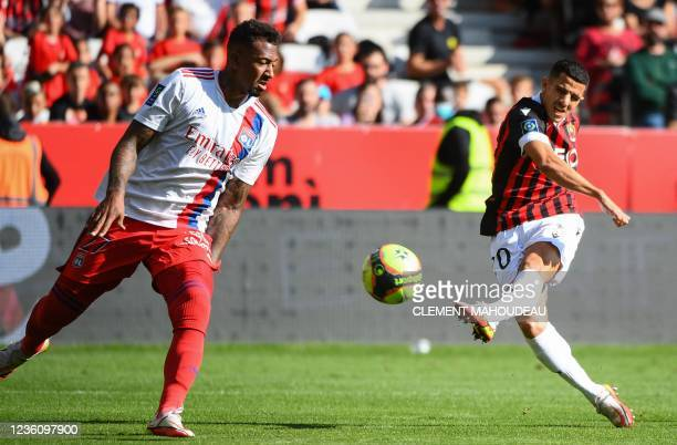 Nice's Algerian defender Youcef Atal kicks to score Nice's first goal during the French L1 football match between OGC Nice and Olympique Lyonnais at...