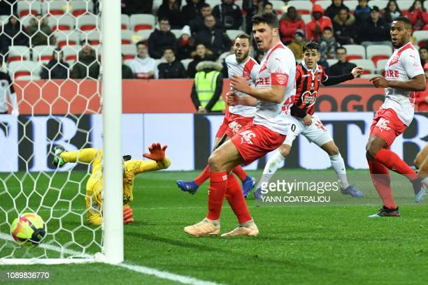 Nice's Algerian defender Youcef Atal shoots and scores a goal during the French L1 football match between Nice and Nimes on January 26 2019 at the...