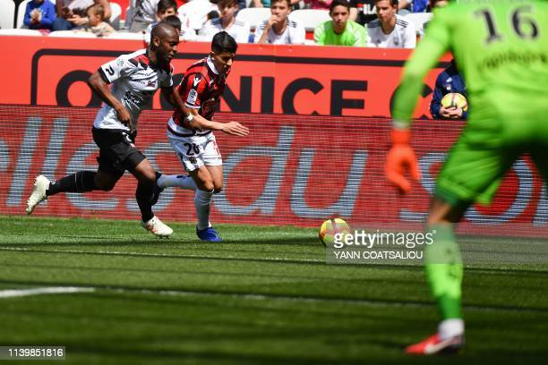 Nice's Algerian defender Youcef Atal vies with Guingamp's Congolese defender Jordan Ikoko during the French L1 football match between OGC Nice and En...