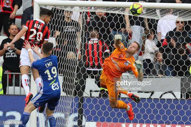 Nice's Algerian defender Youcef Atal vies with Strasbourg's Belgian goalkeeper Matz Sels during the French L1 football match between Nice and...