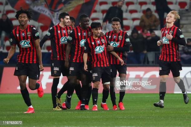 Nice's Algerian forward Adam Ounas is congratulated by teammates after scoring a goal during the French Cup round-of-16 football match between OGC...