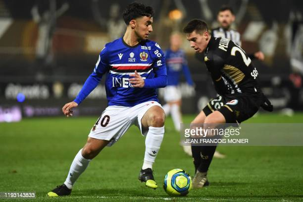 Nice's Algerian forward Adam Ounas vies with Angers' French defender Theo Pellenard during the French L1 football match between Angers SCO and OGC...